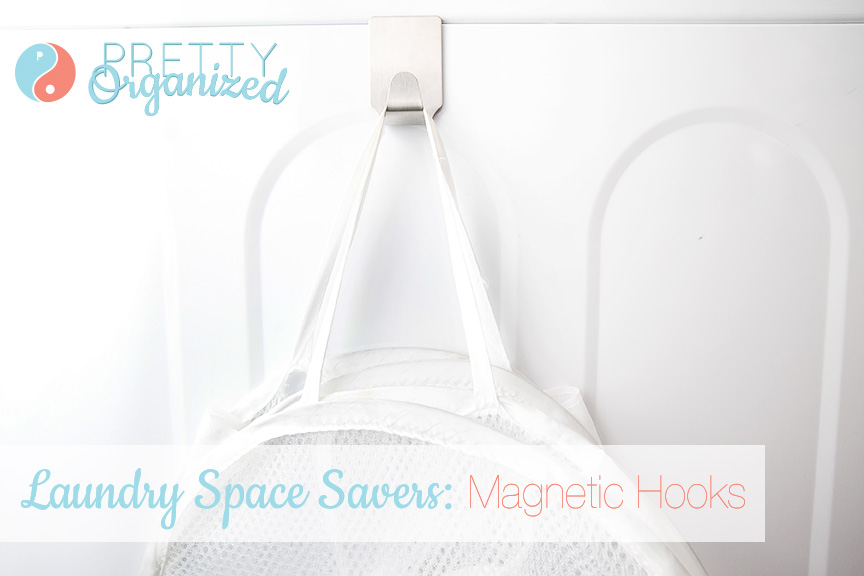 Save space by hanging collapsible laundry baskets on magnetic hooks on the side of your washing machine.