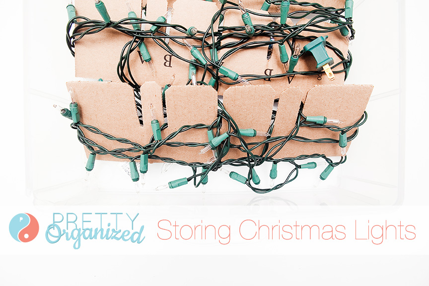 Storing-Christmas-Lights: use cardboard strips to wrap lights and keep them from tangling