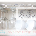 Kitchen Storage Hack: Use Shower hooks & an under-shelf stemware rack to store wine glasses AND mugs!