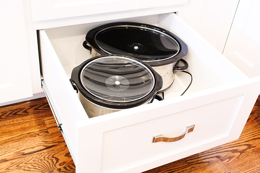 Use deep drawers to store heavy appliances in the kitchen.