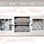 Use a media cabinet as a mini linen closet for guests -- so smart!