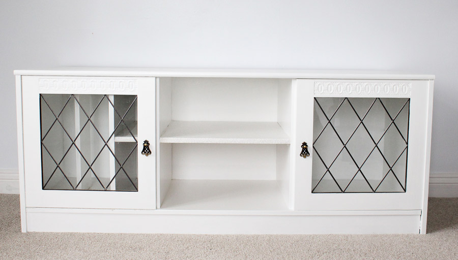Think creatively with storage furniture -- this media cabinet makes a great linen cabinet!