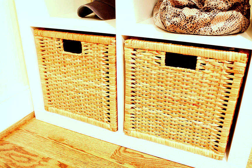 Use baskets to create a command center that catches clutter at the door!