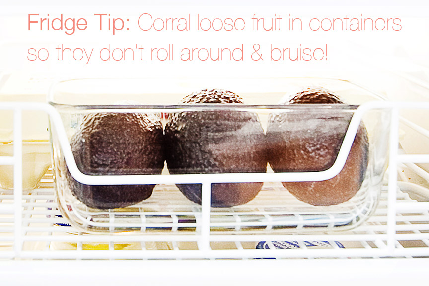 Keep fruit from rolling around & bruising by storing it in a container in your fridge